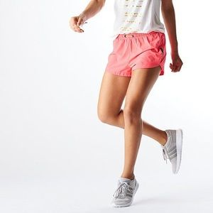 LUCY Revolution Run 3in Woven Shorts Bright Pink